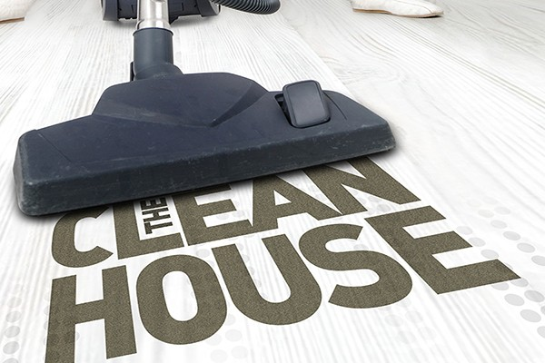 "Clean House poster image: Vacuum cleaner sucking up words ""The Clean House"""