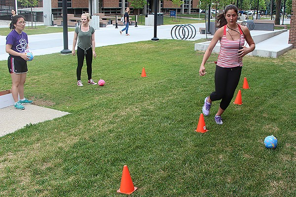 High schooler Shannon Fehr manoeuvres a ball through pylons during an event in the Amazing Science Race.