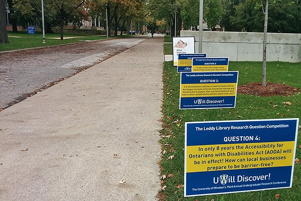 Colourful signs around the campus pose the contending questions to passersby.