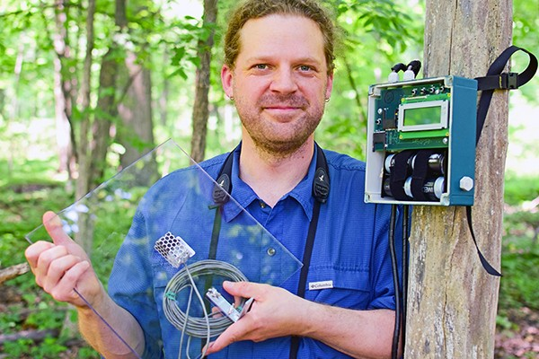 Biology professor Dan Mennill displays some of the sonic equipment used to track birds migrating at night.