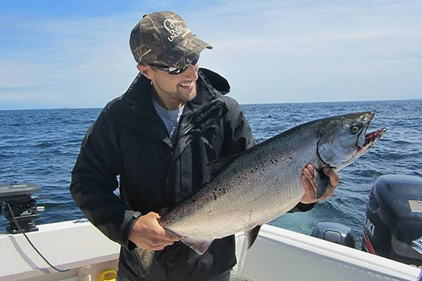 Mitch Dender holding a salmon