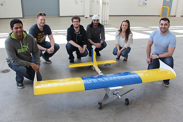 Lancer Aerosports members pose with their completed model aircraft