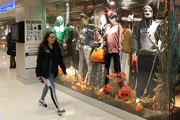 Masks and costumes on display outside the Campus Bookstore