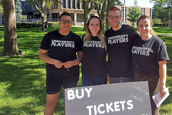 drama students selling University Players tickets