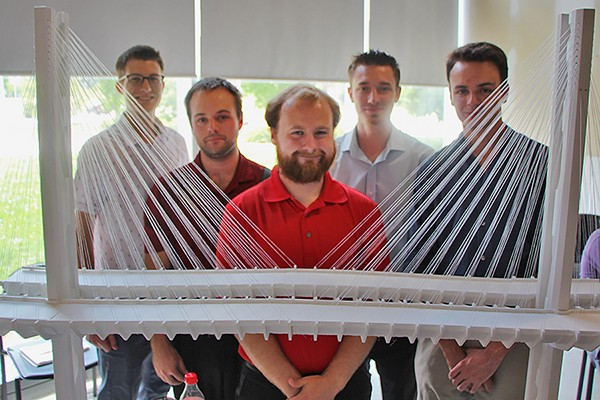 Engineering students George Vereyken, Matthew Lemmon, Cameron McDonald, Nathan Barbarossa and Joshua Haddad display their award-winning design for the Gordie Howe International Bridge.
