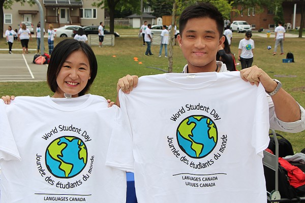 Students holding up World Student Day T-shirts