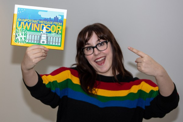 Maddie Renaud shows off a UWindsor offer of admission package.