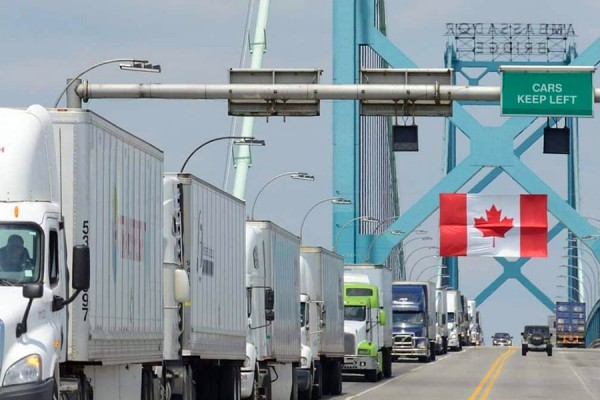 Trucks carrying goods across Ambassador Bridge