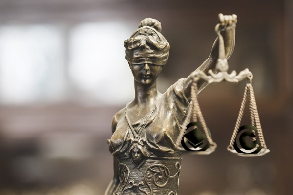scales of justice balancing copyright and academic freedom