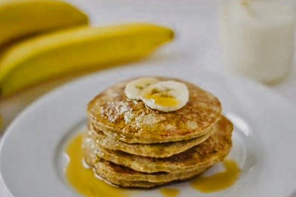 Pancakes topped with sliced banana