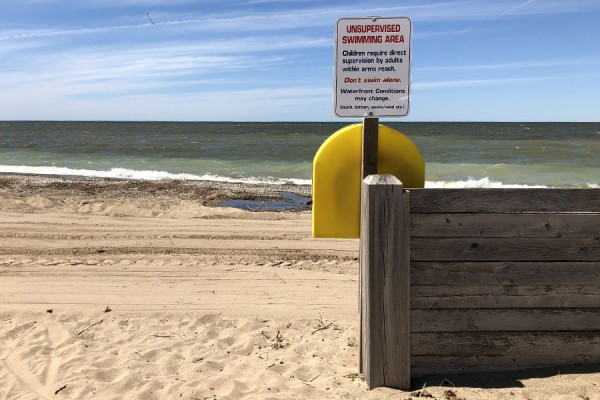 Beach with sign warning posted
