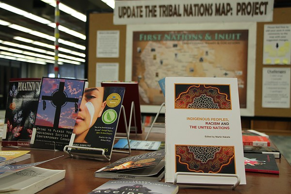 display of books with Tribal Nations map in background