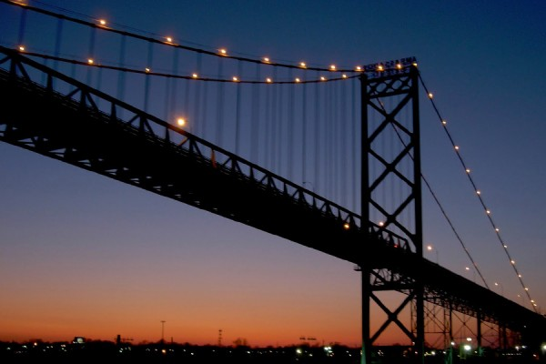 The Ambassador Bridge is pictured from Windsor at sunset.
