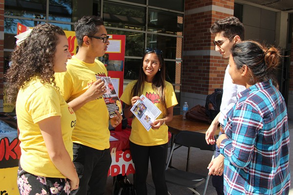 Representatives of the Caring for Cambodia club try to recruit some new members during Club Days activities Monday.