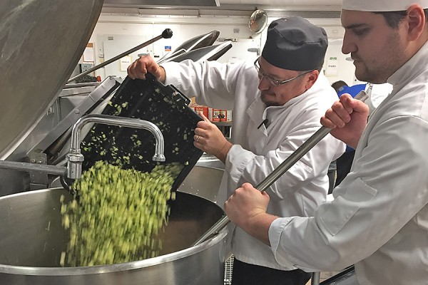 Chefs prepare a big batch of the famous Food Services vegetarian chili.