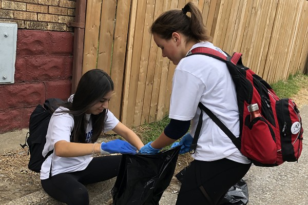 Volunteers pick up litter during #OurCommunity Clean-up Day, Sept. 9.