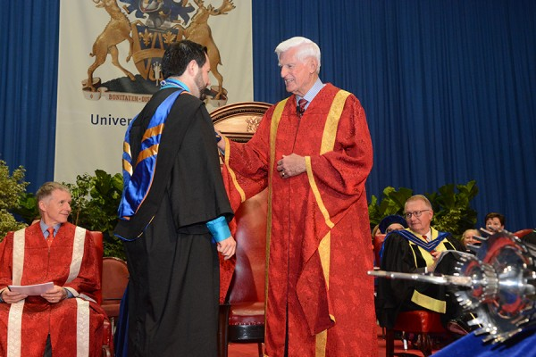 Chancellor greeting graduand during Convocation ceremony