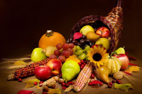 woven cornucopia spilling over with produce