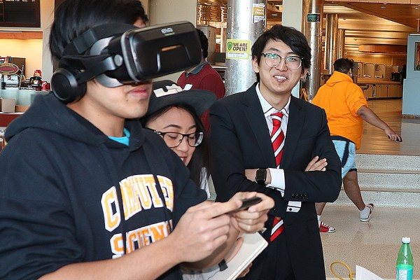Students try out virtual reality during Computer Science Demo Day, Monday in the student centre.