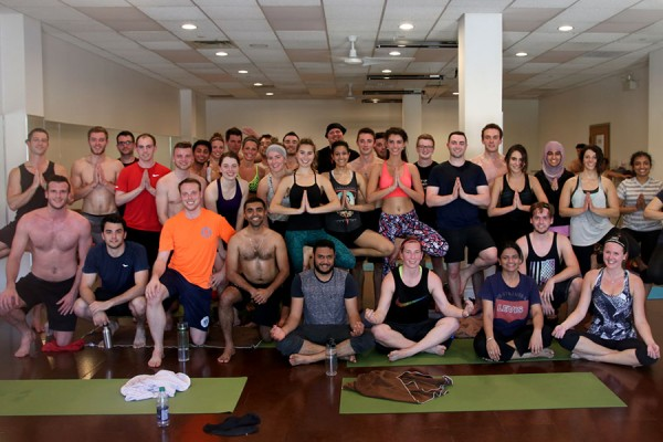 Students in the Odette MBA program strike a pose following a hot yoga class as part of a de-stress day on Monday, May 8.