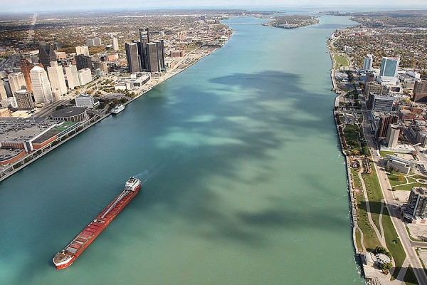 aerial photo of Detroit River showing cities on both banks