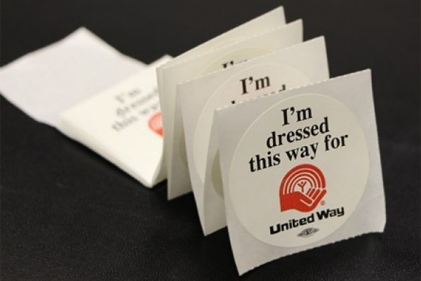 "Stickers reading ""I am dressed this way for United Way"""