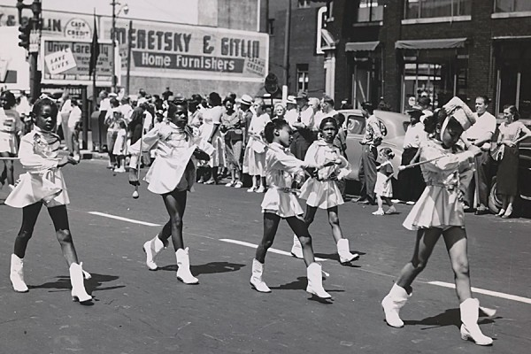 Majorettes spinning batons in parade