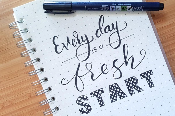 "Pad with message written ""Every day is a fresh start"""