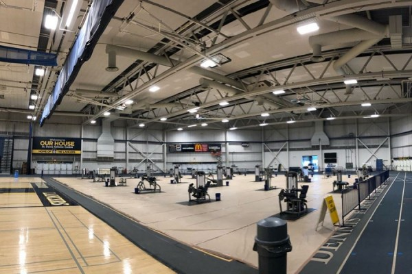 fieldhouse showing exercise equipment spaced apart