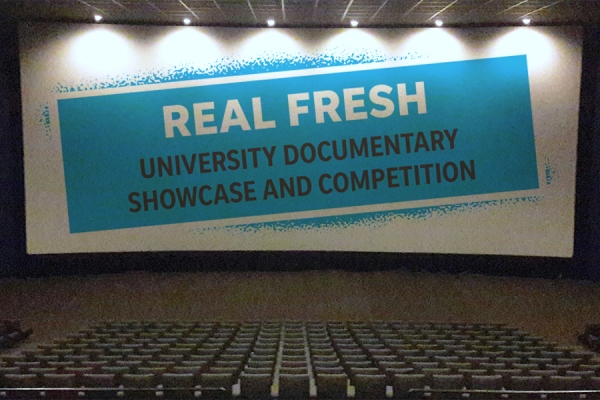 "Movie screen displaying ""Real Fresh"" student film showcase"