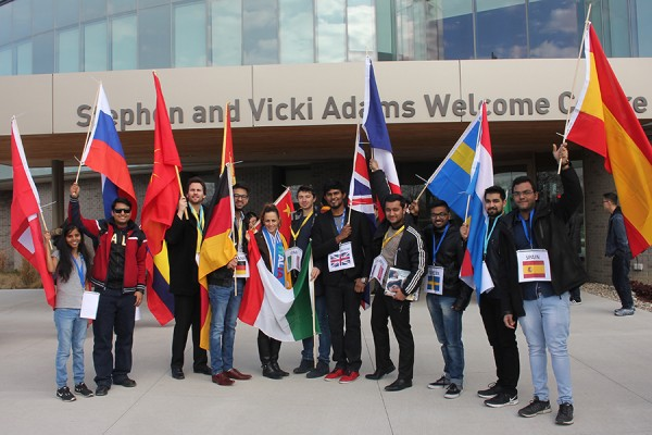Flag bearers pose outside Welcome Centre