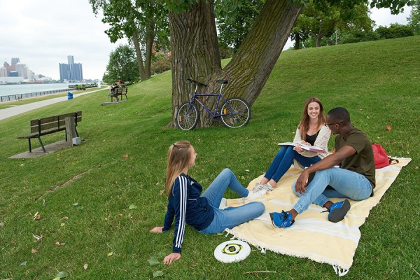 students sitting on lawn