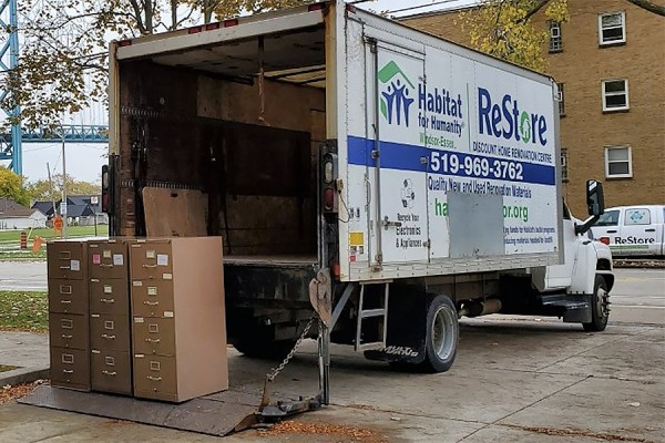 Habitat for Humanity truck loading filing cabinets