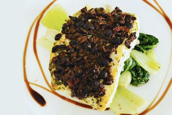 Filet of halibut surrounded with balsamic glaze