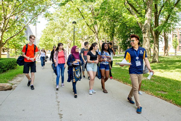 student leading campus tour