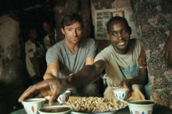 Hugh Jackman learns about the value of fair trade coffee on the Ethiopian farm of host Dukale.