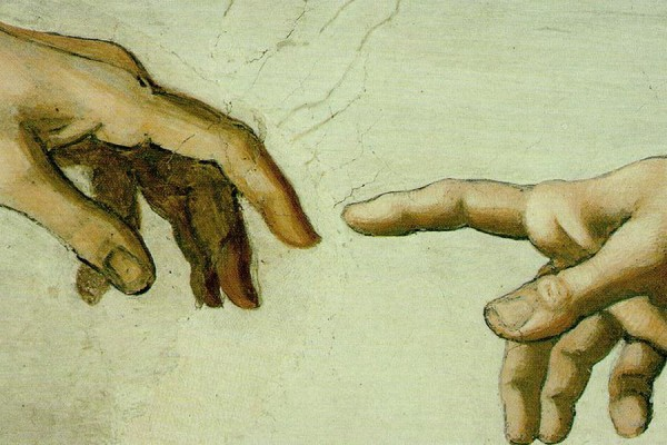 close-up of hands from Michaelangelo's Creation of Adam