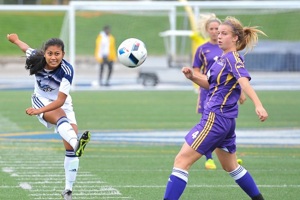 Windsor midfielder Jade Samping puts boot to ball in action against Laurier.