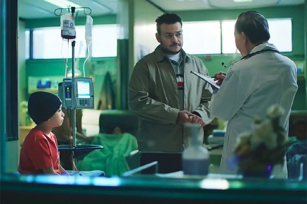 Child, father, doctor in hospital setting