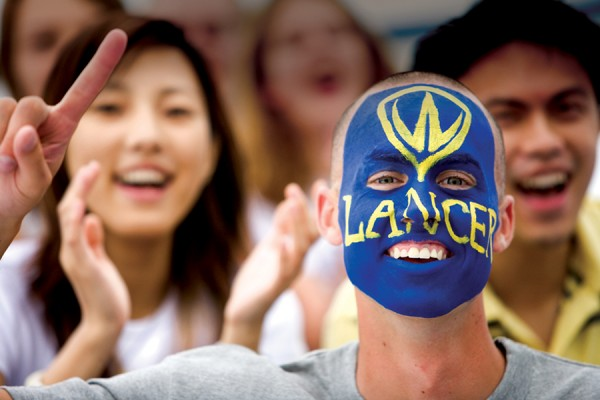 Lancer fan with face painted blue and gold