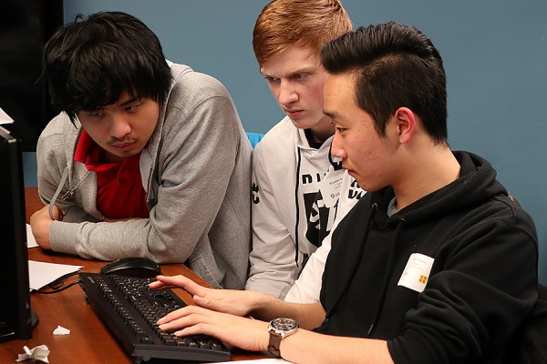 A team from Leamington District Secondary School works on code during the Regional Secondary School Computer Programming Competition, December 1 at the University of Windsor.
