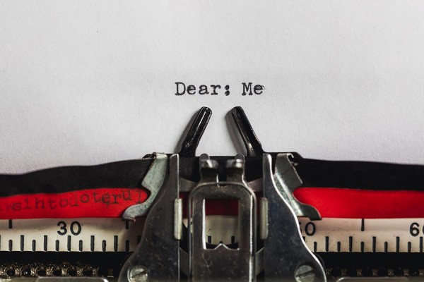"Typewriter with page in it reading ""Dear: Me"""