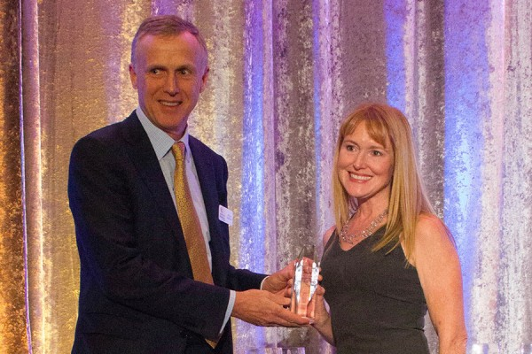 UWindsor associate professor Lisa Porter receives the 2018 David Kelly Award for Community Service from Chris Sullivan, chair of the board of directors of the Brain Tumour Foundation of Canada.