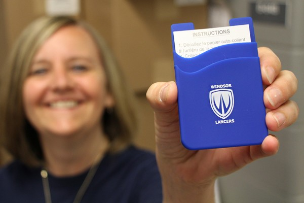 Bookstore clerk Marnie Pinkney shows off the Lancer smartphone wallet, available for just $4.50.