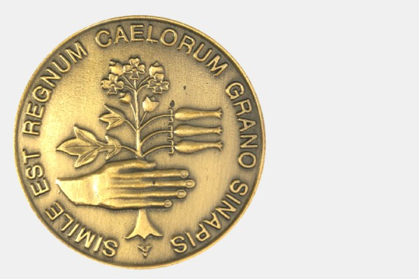 "the Christian Culture Gold Medal depicts a human hand holding a mustard plant with the Latin inscription ""the kingdom of heaven is like a mustard seed."""