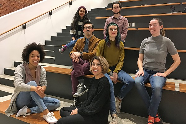 MFA students sitting on stairs