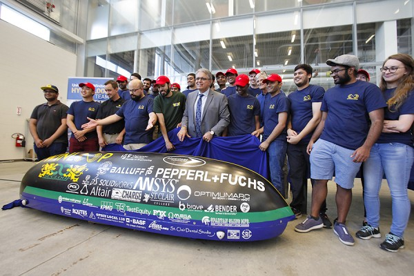 University officials and team members unveil Windsor's entry in the SpaceX Hyperloop Pod Competition.