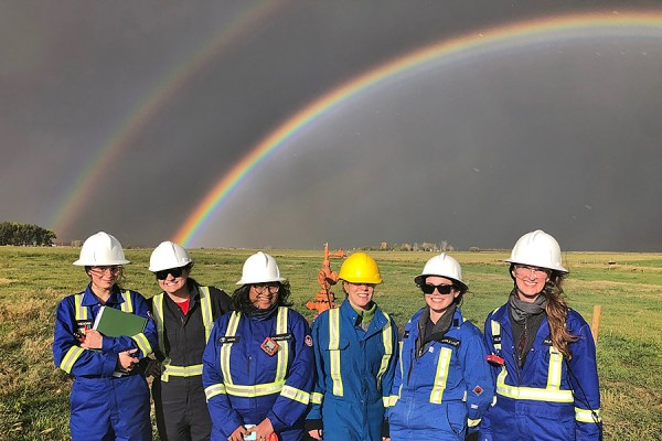 students standing under rainbow