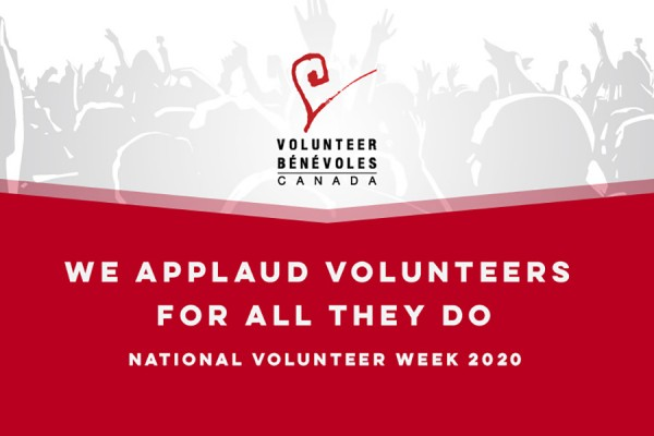 "placard reading ""National Volunteer Week"""