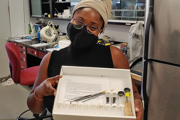 Patricia Okpara holding insect collection kit